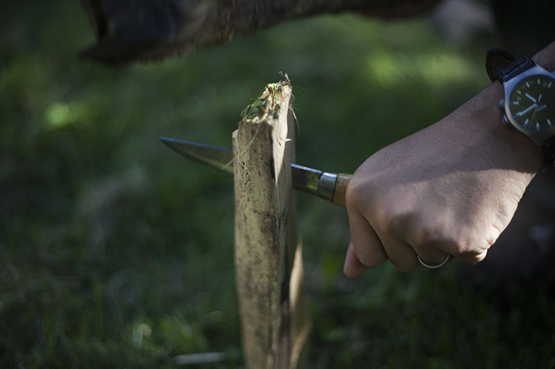 batoning with survival outdoor use knife
